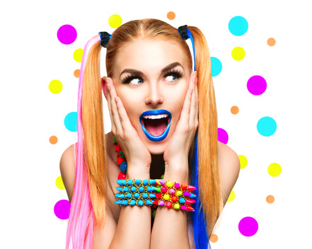 Beauty funny girl portrait with colorful makeup, hair and accessories Stock Photo