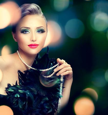 black boa: Beautiful luxury woman portrait over dark blurred background