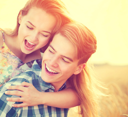 young boy smiling: Young couple having fun outdoors. Love concept