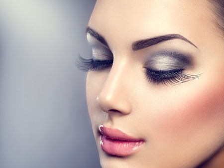 smoky eyes: Beautiful fashion luxury makeup. Long eyelashes, perfect skin