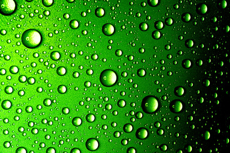 Water drops closeup. Abstract green background