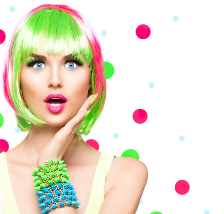 hair feathers: Surprised beauty fashion model girl with colorful dyed hair