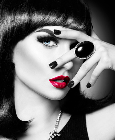 makeup: Beautiful mysterious brunette lady portrait. Black and white