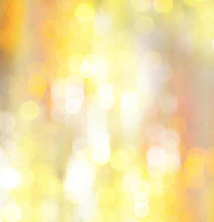xmass: Abstract holiday glowing golden background. Christmas holiday glowing abstract glitter defocused blinking lights Stock Photo