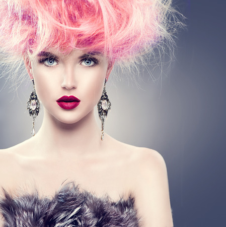 High fashion model girl with updo hairstyle and stylish makeup