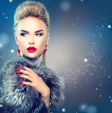 red nail colour: Beauty fashion model girl in blue fox fur coat