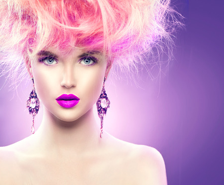 bright: High fashion model girl with updo hairstyle and stylish makeup