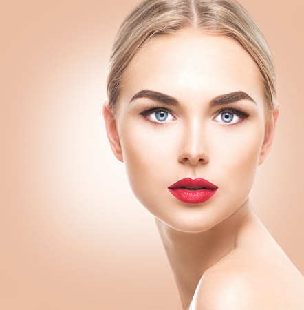 Beautiful blonde model girl with blue eyes and perfect make-up