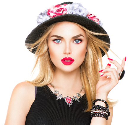 red nail colour: Beautiful sexy blonde woman with red lips and manicure in modern black hat