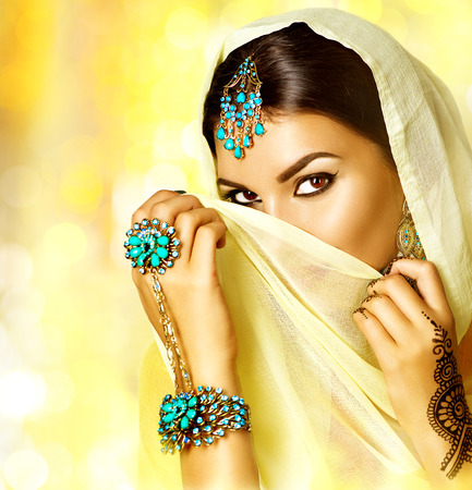 costume jewelry: Beautiful arabic woman portrait. Arabian girl with menhdi tattoo Stock Photo