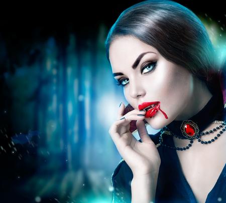 ハロウィン吸血鬼の女性の美しい肖像画。美しさセクシーなヴァンパイア