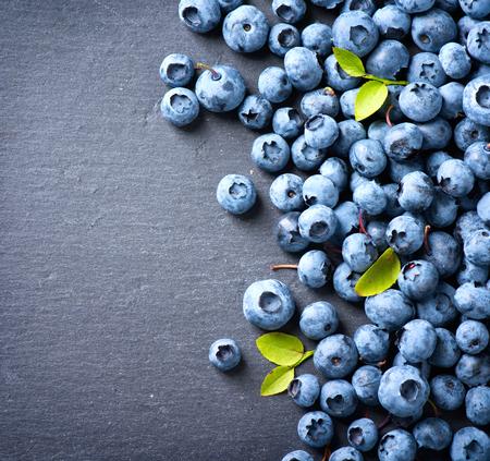 blueberries: Blueberry border design. Blueberries background Stock Photo