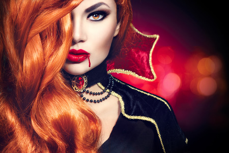 long red hair woman: Halloween vampire woman portrait. Beautiful glamour fashion sexy vampire Stock Photo
