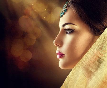 model: Beautiful fashion Indian woman profile portrait with oriental accessories