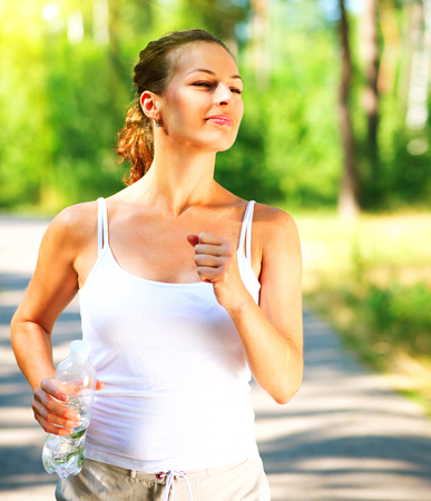 sporty: Beautiful sporty woman jogging outdoor Stock Photo