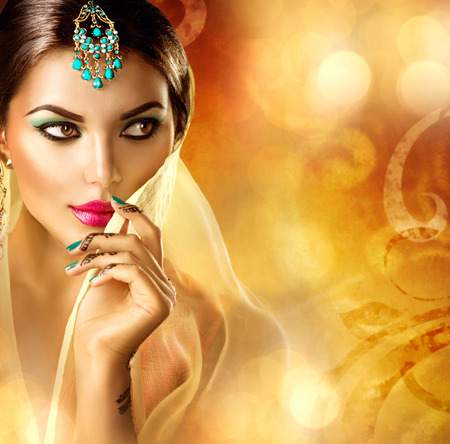 makeup fashion: Beautiful arabic woman portrait. Arabian girl with menhdi tattoo Stock Photo