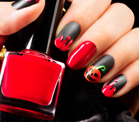 red nail colour: Halloween nail art design. Nail polish