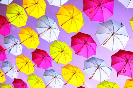 vivid: Hanging multicolored umbrellas over blue sky