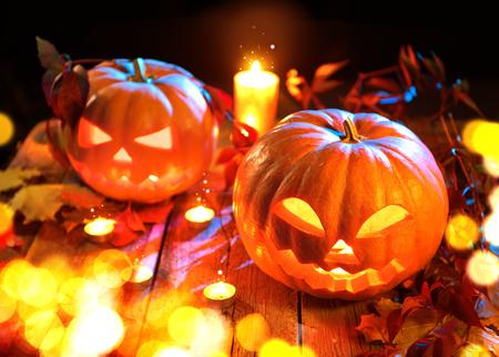 carved pumpkin: Halloween pumpkin head jack lantern with burning candles