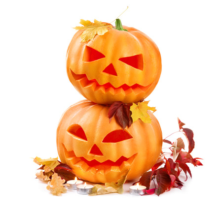 pumpkin head: Halloween pumpkin head jack lantern with burning candles isolated on white background