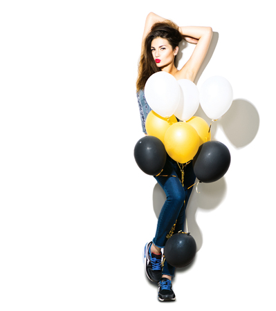 white party: Full length portrait of beauty fashion model girl with colorful balloons