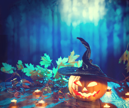 Halloween pumpkin head jack lantern with burning candle