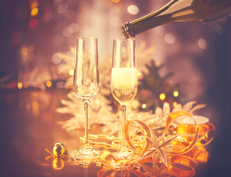 champagne flute: Christmas celebration. New Year holiday decorated table. Vintage toned Stock Photo