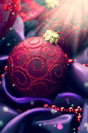 christmas decorations: Christmas and New Year decoration on violet silk Stock Photo