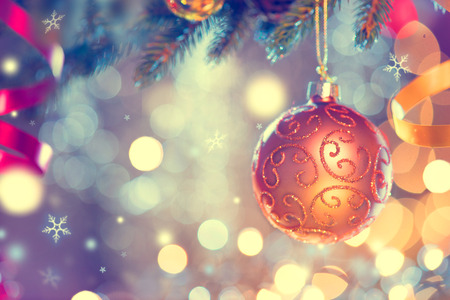 holidays: Christmas and New Year decoration. Golden bauble hanging on Christmas Tree