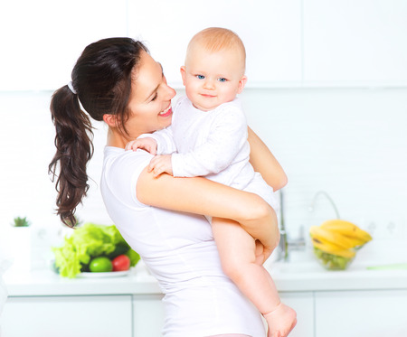 parents with baby: Mother and baby together. Dieting concept. Healthy eating Stock Photo