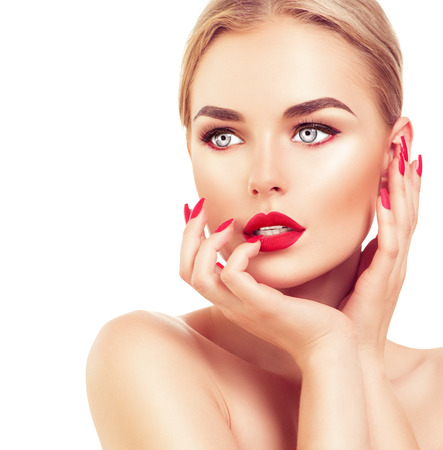 Beautiful fashion model woman with blond hair, red lipstick and nails 스톡 콘텐츠