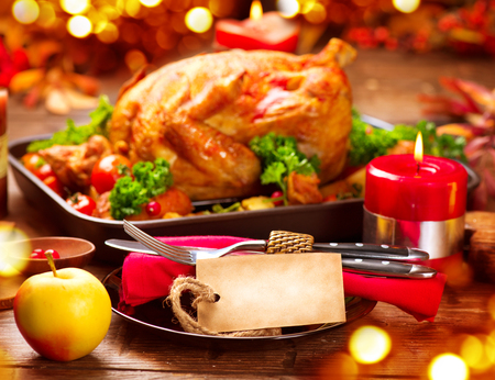 holiday turkey: Thanksgiving dinner table served with turkey, decorated with bright autumn leaves
