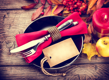 fork: Thanksgiving wooden table served, decorated with bright autumn leaves Stock Photo