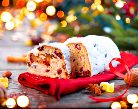 stollen: Christmas stollen. Traditional sweet fruit loaf with icing sugar