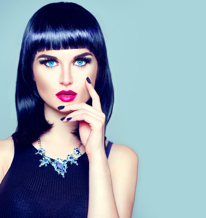 short: High fashion model girl portrait with trendy fringe hairstyle, makeup and manicure
