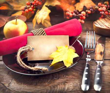served: Thanksgiving dinner wooden table served, decorated with bright autumn leaves Stock Photo