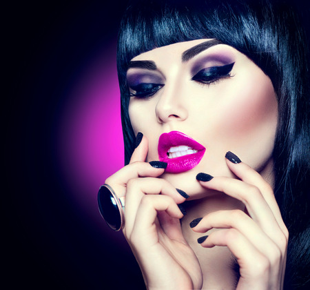 black hair: High fashion model girl portrait with trendy fringe hairstyle, makeup and manicure