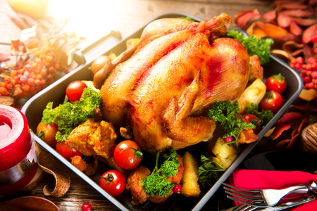 potato tree: Roasted turkey garnished with potato, vegetables and cranberries. Thanksgiving or Christmas dinner