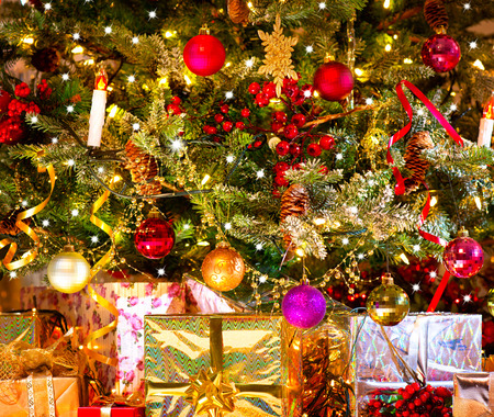 under tree: Holiday Christmas scene. Gifts under the Christmas tree