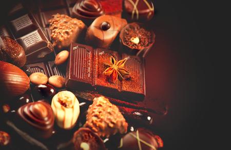Chocolate background closeup. Delicious assortment of white, dark, milk chocolate