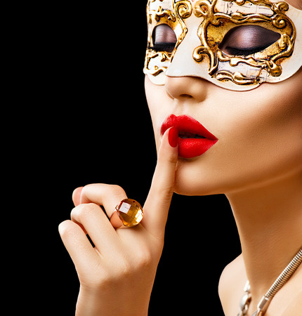 black mask: Beauty model woman wearing venetian masquerade carnival mask at party