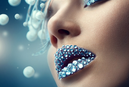 jewelries: Christmas girl. Holiday makeup with gems on lips