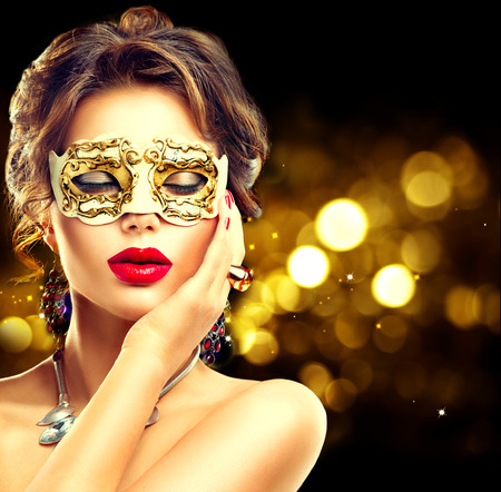 facial: Beauty model woman wearing venetian masquerade carnival mask at party