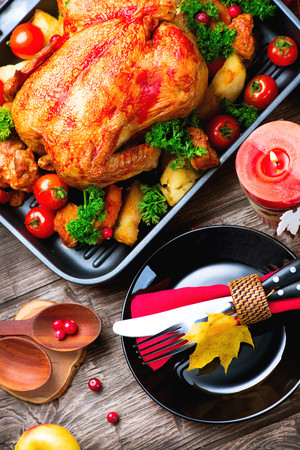 decorated: Thanksgiving dinner table served with turkey, decorated with bright autumn leaves