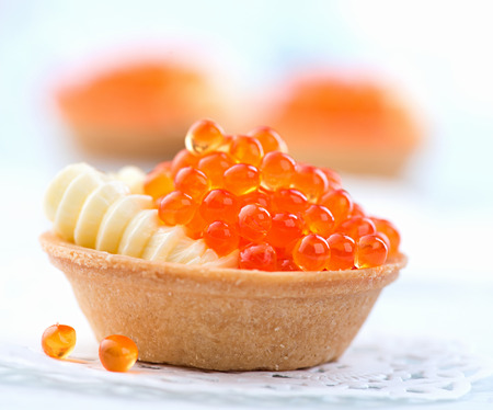tartlet: Tartlet with red caviar closeup. Gourmet food