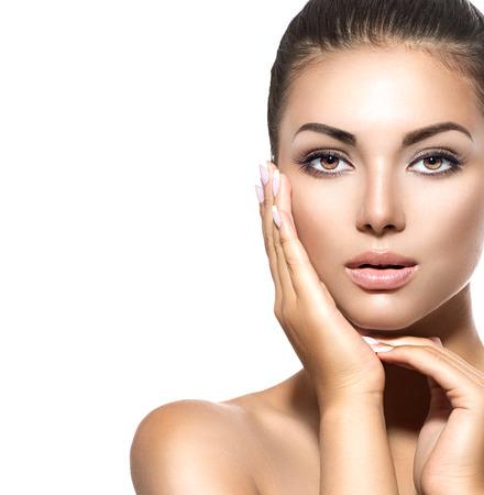 Beauty portrait. Beautiful spa brunette woman touching her face