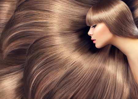 Beautiful hair. Beauty woman with shiny long hair as background Reklamní fotografie - 48483598
