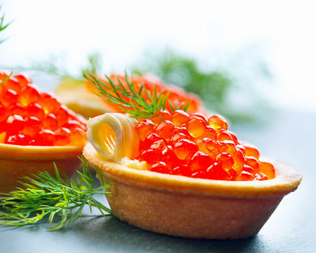 tartlet: Tartlets with red caviar closeup. Gourmet food