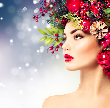 gorgeous woman: Christmas fashion model woman. Holiday hairstyle and makeup