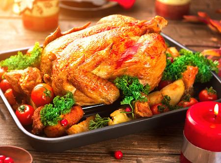 roasted turkey: Christmas dinner. Roasted turkey on holiday served table Stock Photo